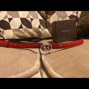 Thin band red Gucci belt